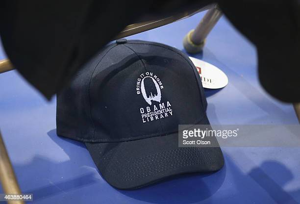 A hat promoting Chicago for the location of Obama Presidential Library sits under a chair as guests wait for the arrival of President Barack Obama at...