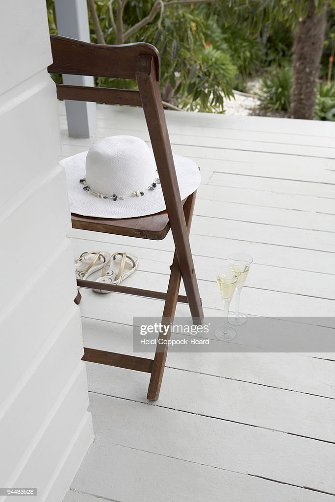 hat sandals and 2 glasses of bubbles : Stock Photo