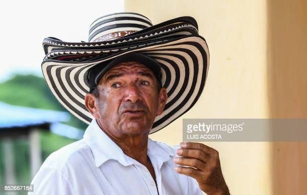 A hat seller plies his trade in Santa Cruz de Mompox Department of Bolivar September 23 2017 the Colombian town on the banks of the great river...