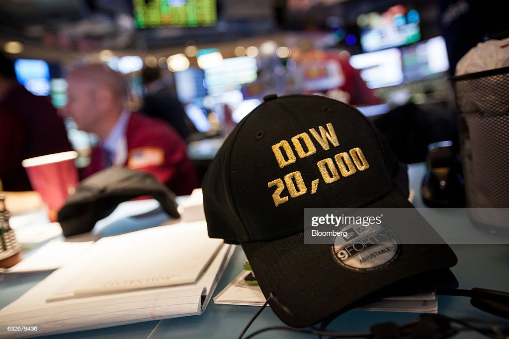A 'DOW 20,0000' hat sits on a desk on the floor of the New York Stock Exchange (NYSE) in New York, U.S., on Wednesday, Jan. 25, 2017. The Dow Jones Industrial Average climbed past 20,000 for the first time as stocks around the world extended a rally after corporate earnings reignited investors' optimism in economic growth. Bonds sold off with oil. Photographer: Michael Nagle/Bloomberg via Getty Images