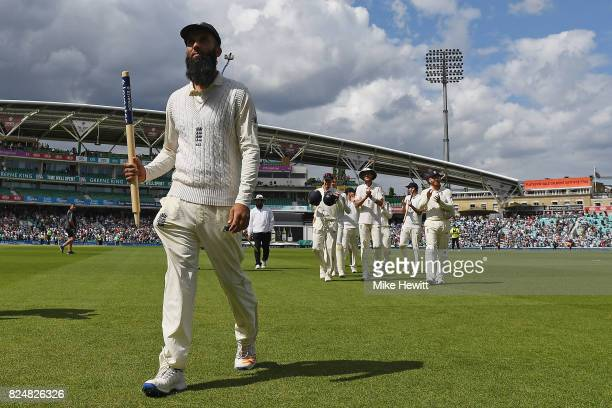 Hat trick hero Moeen Ali of England is applauded off the pitch by his team mates at the end of the 3rd Investec Test between England and South Africa...