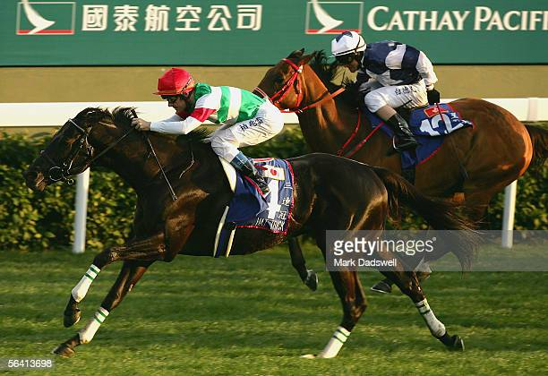 Hat Trick ridden by Olivier Peslier wins the Cathay Pacific Hong Kong Mile during the Cathay Pacific International Races at Shatin Racecourse...