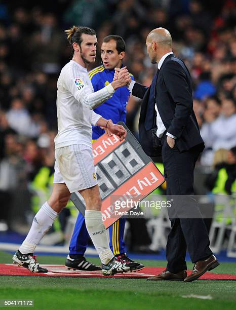 Hat trick scorer Gareth Bale of Real Madrid shakes hands with Zinedine Zidane manager of Real Madrid as he is substituted during the La Liga match...