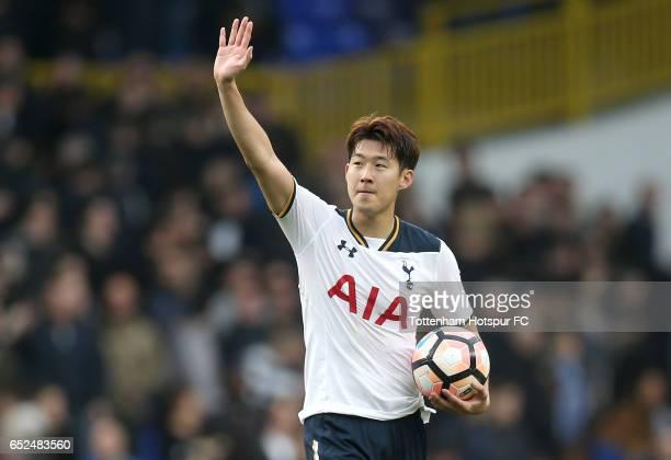 Hat trick scorer Heung-Min Son of Tottenham Hotspur celebrates with the match ball after The Emirates FA Cup Quarter-Final match between Tottenham...