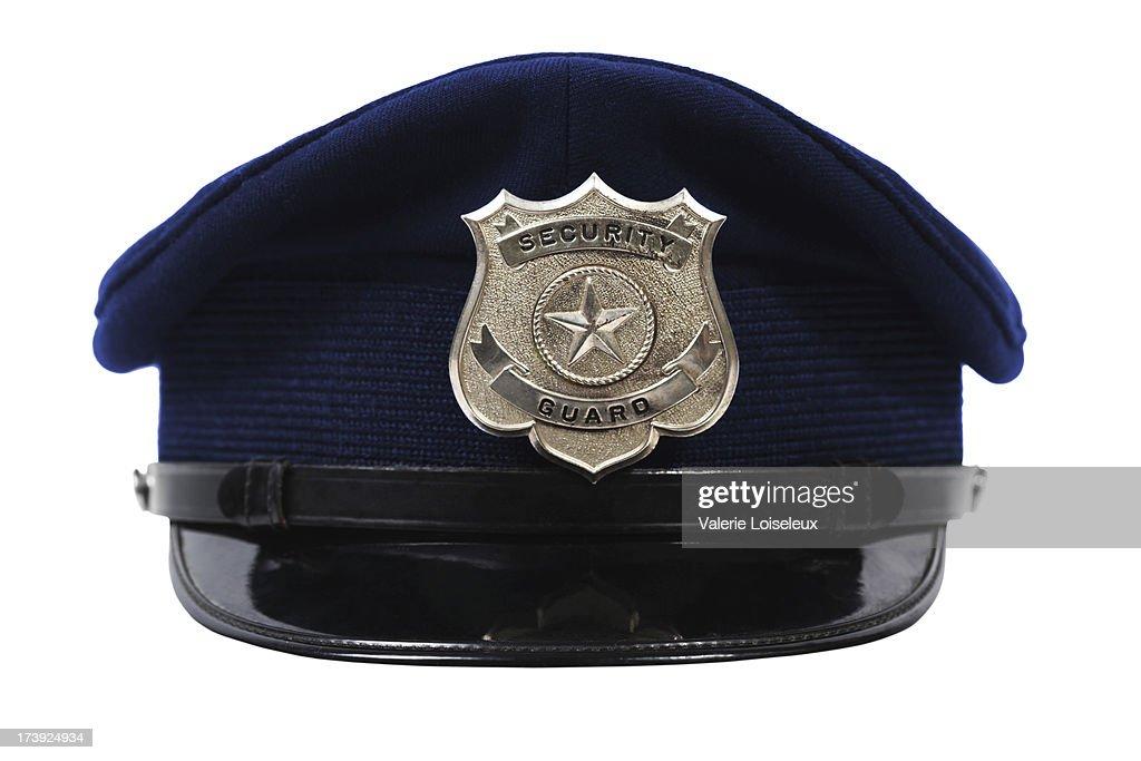 帽子、警備員バッジ : ストックフォト