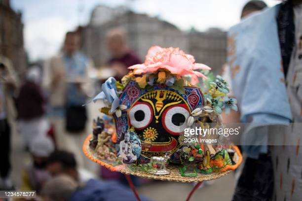 Hat with the Lord Jagannatha image and other decorations representing the circle of life is seen during the parade. Thousands of religious Hindu...