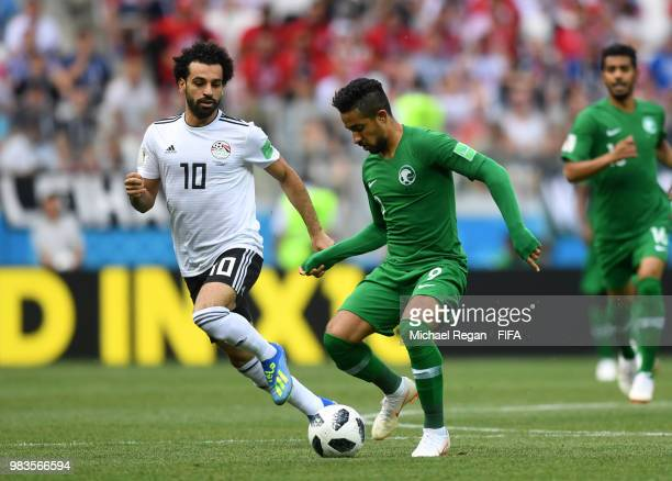 Hatan Bahbir of Saudi Arabia is challenged by Mohamed Salah of Egypt during the 2018 FIFA World Cup Russia group A match between Saudia Arabia and...