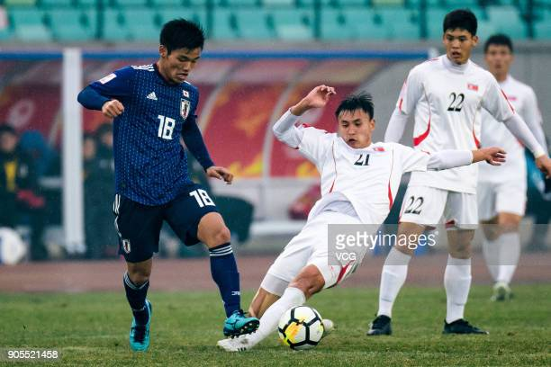 Hatate Reo of Japan and Kim Nam-Il of North Korea compete for the ball during the AFC U-23 Championship Group B match between Japan and North Korea...
