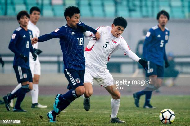 Hatate Reo of Japan and Ri Un-Chol of North Korea compete for the ball during the AFC U-23 Championship Group B match between Japan and North Korea...
