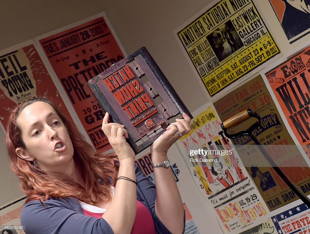 Hatch Show Print tour guide Rebecca Sloan, addresses attendees during the Hatch Show Print tour on July 12, 2014 in Nashville, Tennessee.