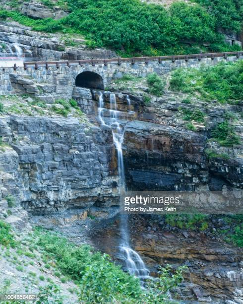 hatcheck creek flows under the going to the sun road in glacier national park and plunges into the canyon below. - wpa stock pictures, royalty-free photos & images