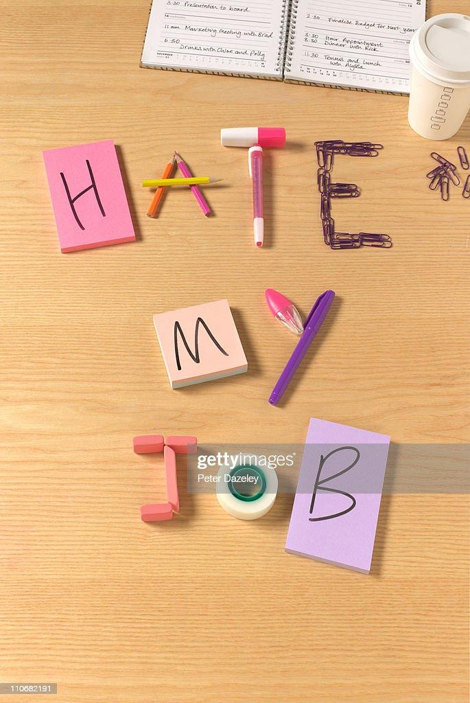I hate my job office desk : Stock Photo
