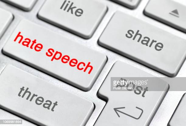 hate speech on keyboard - fake news fotografías e imágenes de stock