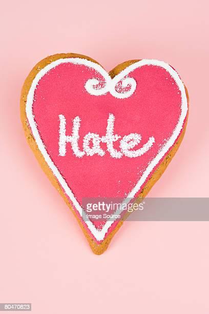 Hate written on heart shaped candy