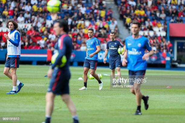 Hatem Ben Arfa and Unai Emery head coach of PSG during the training session of Paris Saint Germain at Parc des Princes on May 16 2018 in Paris France