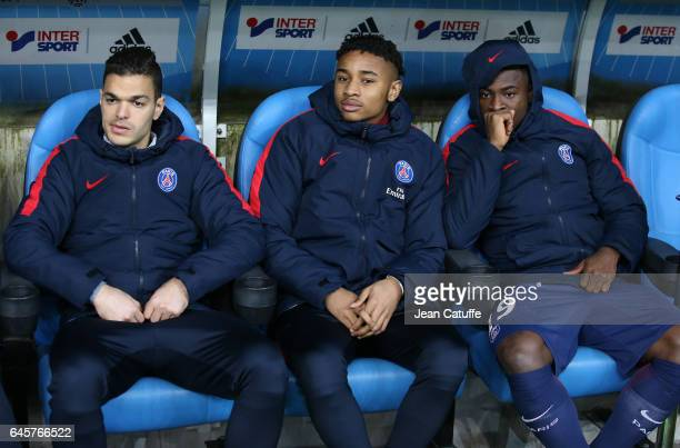 Hatem Ben Arfa Christopher Nkunku Serge Aurier of PSG seat on the bench during the French Ligue 1 match between Olympique de Marseille and Paris...