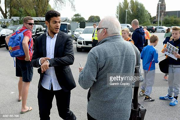 Hatem Ben Arfa of Hull City gestures to fans after signing autographs for fans before the Barclays Premier League match between Hull City and...