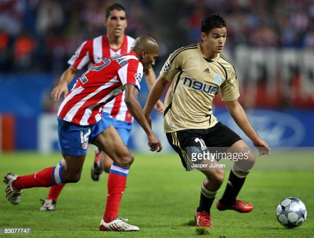 Hatem Ben Arfa of Marseille duels for the ball with Paulo Assuncao of Atletico Madrid during the UEFA Champions League Group D match between Atletico...