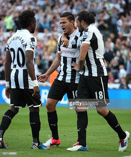 Hatem Ben Arfa of Newcastle United celebrates with Jonas Gutierrez after scoring the equalizing goal during the Barclays Premier League match between...