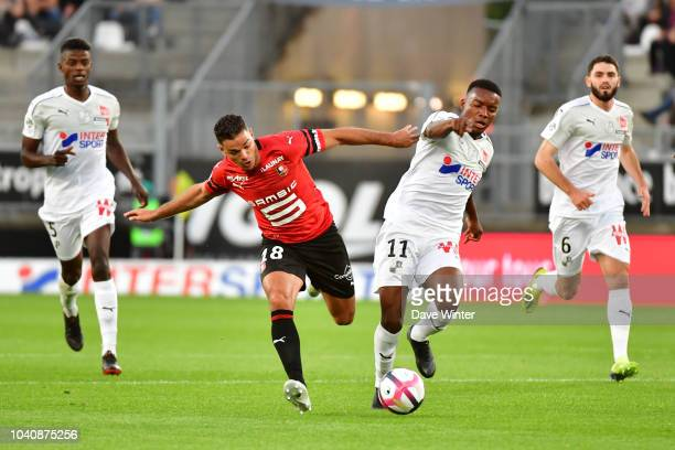 Hatem Ben Arfa of Rennes and Juan Ferney Otero of Amiens during the Ligue 1 match between Amiens and Rennes at Stade de la Licorne on September 26...