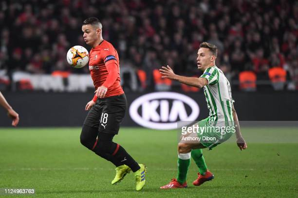 Hatem Ben Arfa of Rennes and Sergio Canales of Real Betis during the UEFA Europa League Round of 32 First Leg match between Rennes and Real Betis at...