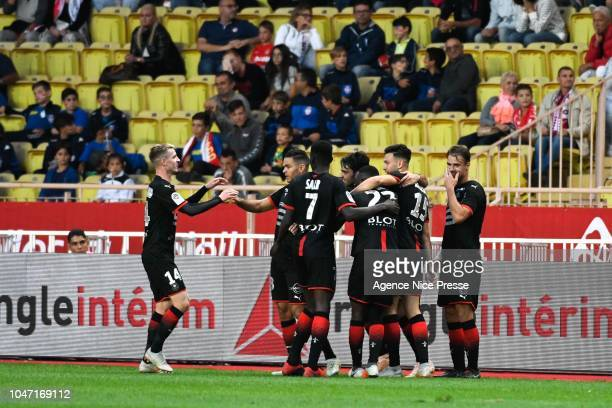 Hatem Ben Arfa of Rennes celebrates his goal with teammates during the Ligue 1 match between Monaco and Rennes at Stade Louis II on October 7 2018 in...
