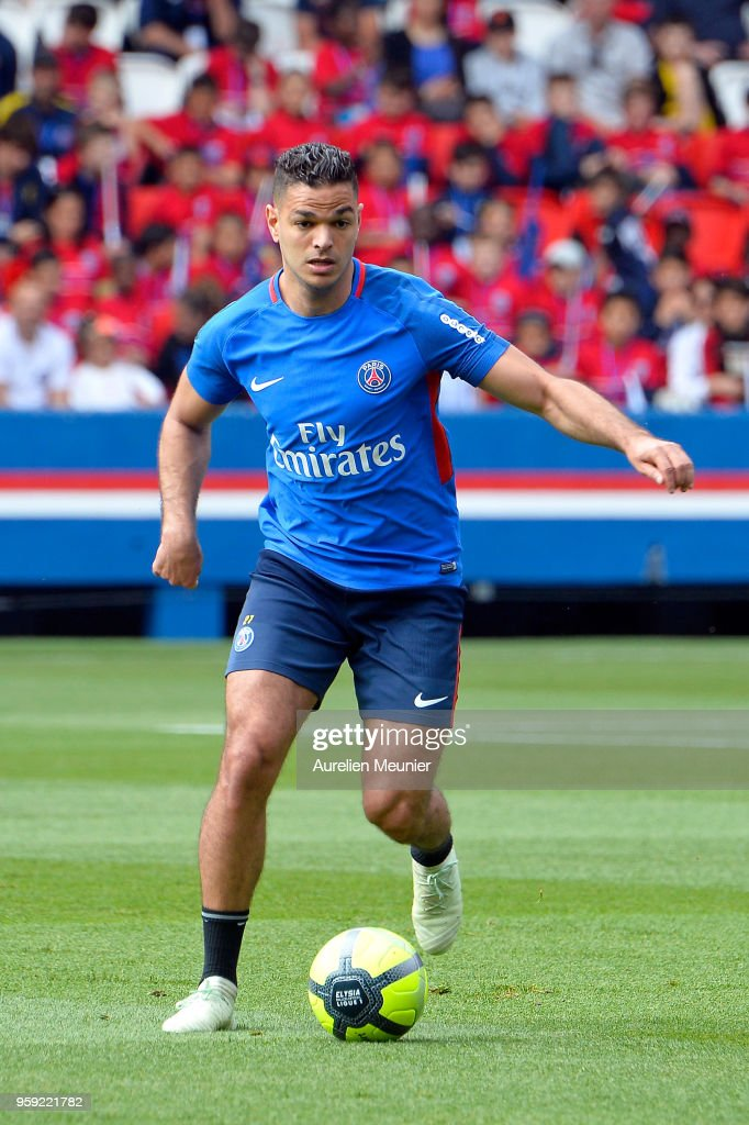 Hatem Ben Arfa runs with ball during a Paris Saint-Germain training session at Parc des Princes on May 16, 2018 in Paris, France.