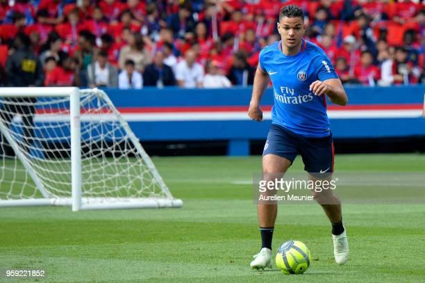 Hatem Ben Arfa runs with ball during a Paris SaintGermain training session at Parc des Princes on May 16 2018 in Paris France