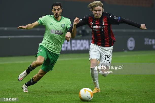 Hatem Elhamed of FC Celtic Glasgow and Jens Petter Hauge of AC Milan battle for the ball during the UEFA Europa League Group H stage match between AC...