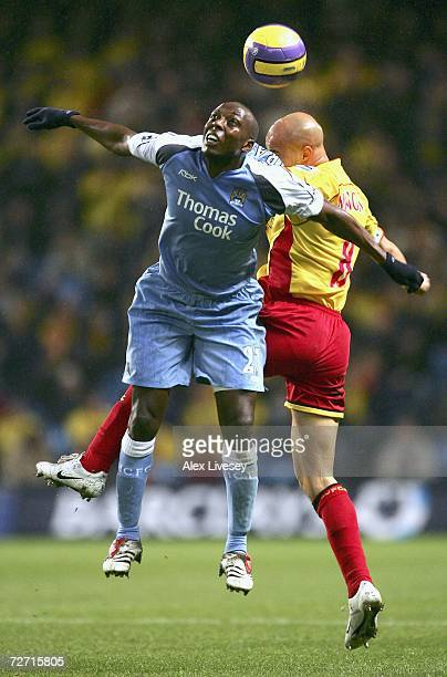Hatem Trabelsi of Manchester City jumps for a header with Gavin Mahon of Watford during the Barclays Premiership match between Manchester City and...