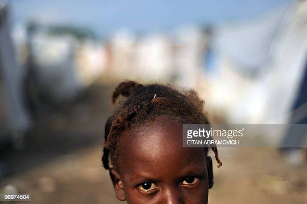 A Hatian girl stands amid tents in a camp near Cite Soleil a slum in PortauPrince on February 21 2010 The earthquake that devastated Haiti on January...