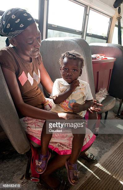 Hatian mother sitting in old bus