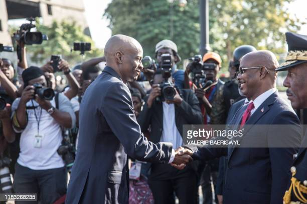Hatian President Jovenel Moise greets Prime Minister Jean Michel Lapin at the MUPANAH before a military parade to commemorate Battle of Vertieres...