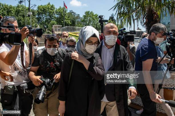 Hatice Cengiz, the fiancee of murdered Washington Post journalist Jamal Khashoggi, arrives to speak to the media after the first session of the...