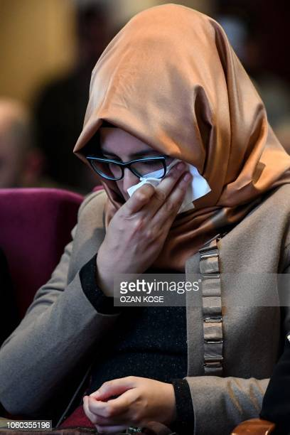 Hatice Cengiz, the Turkish fiance of killed Saudi journalist, wipes her tears during a commemoration event in Istanbul for her fiance on November 11,...