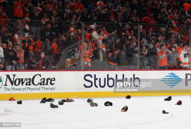 Hats adorn the ice following a hattrick by Claude Giroux of the Philadelphia Flyers against the New York Ranger at the Wells Fargo Center on April 7...