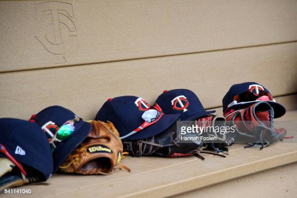 95123cc0fce Hats and gloves of the Minnesota Twins are seen in the dugout during game  one of