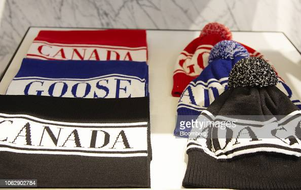 b03b63e74e1 Hats and scarves sit on display at the new Canada Goose Holdings Inc ...