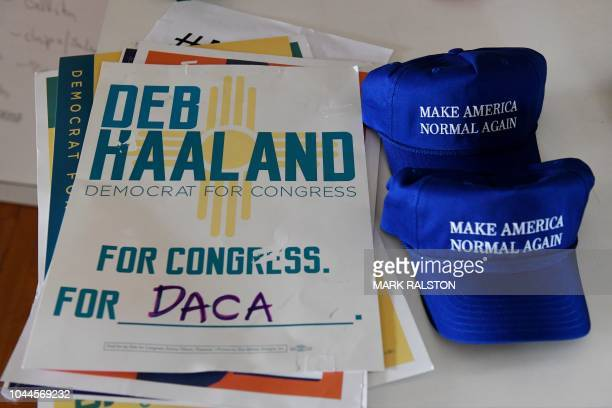 Hats and signs for Native American candidate Deb Haaland who is running for Congress in New Mexico's 1st congressional district seat for the upcoming...