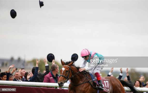 Hats are thrown in the air as Frankie Dettori riding Enable win The Prix de l'Arc de Triomphe during Prix de l'Arc de Triomphe meeting at Chantilly...