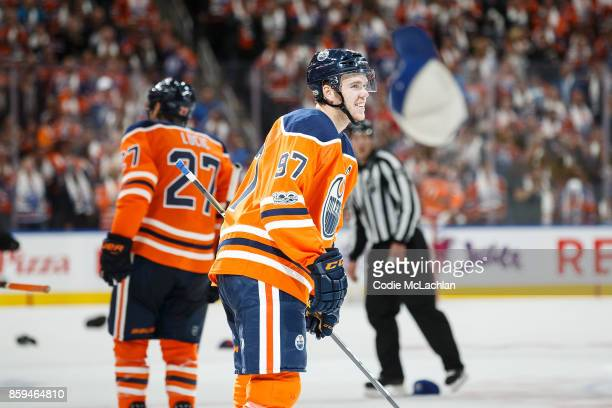 Hats fly as Connor McDavid of the Edmonton Oilers celebrates his hat trick goal against the Calgary Flames at Rogers Place on October 4 2017 in...