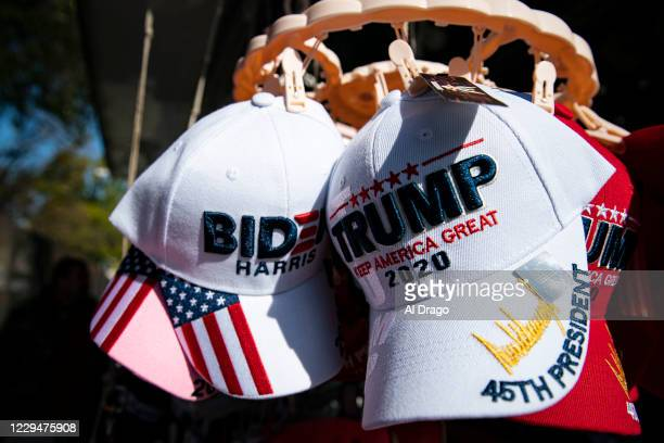 Hats for sale supporting Democratic presidential nominee Joe Biden and U.S. President Donald Trump hang for sale near the White House, on November 5,...