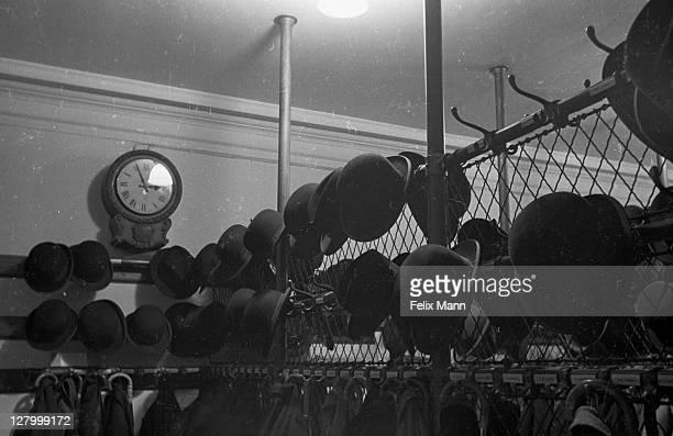 hats hanging up - 1939 stock-fotos und bilder