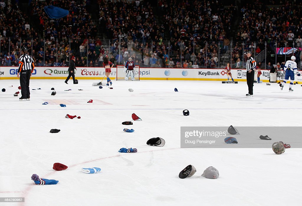 Hats litter the ice as Nathan MacKinnon #29 of the Colorado Avalanche scores his third goal of the game against the Tampa Bay Lightning at Pepsi Center on February 22, 2015 in Denver, Colorado. MacKinnon scored a hat trick as the Avalanche defeated the Lightning 5-4.