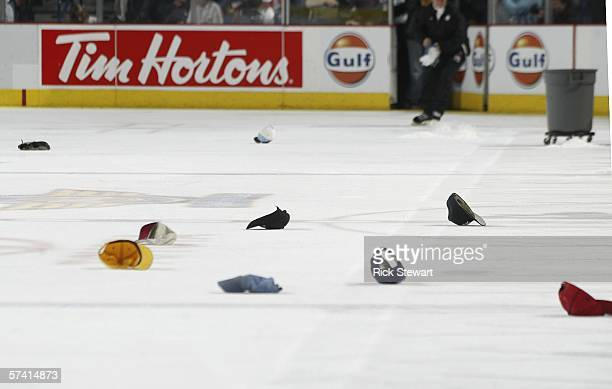 Hats thrown onto the ice in salute of Buffalo Sabres' JP DuMont's hat trick or three goals in a game are shown in the second period against the...