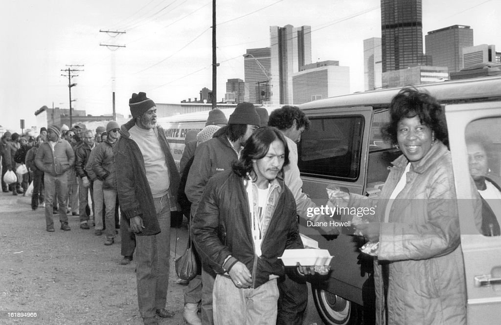 ; Hattie Anthony feeds the destitute at 22nd and Larimer St. Friday.;