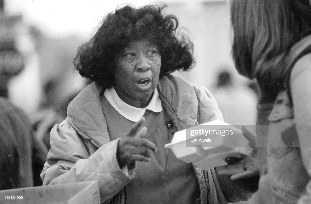 DEC 18 1987; Hattie Anthony hands out holiday dinners at 22nd and Larimer they had enough to serve 3