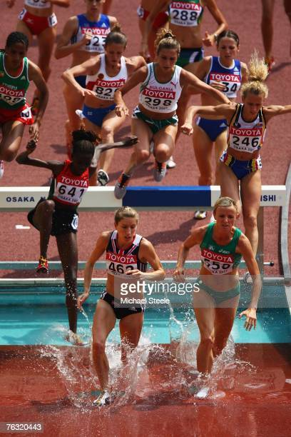 Hattie Dean of Great Britain and Roisin McGettigan of Ireland lead the field through the water jump while competing during the Women's 3000m...