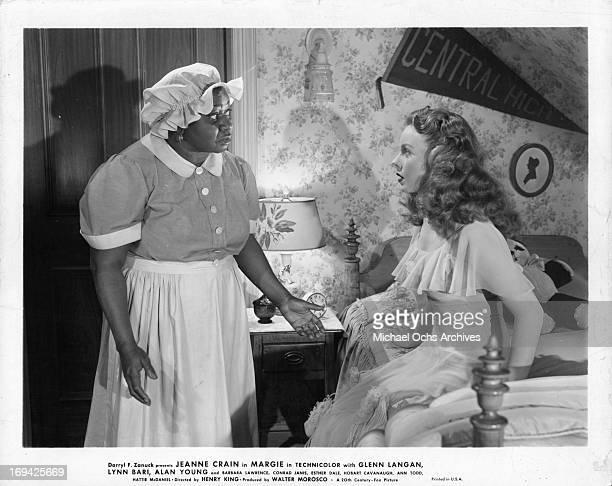 Hattie McDaniel talking to Jeanne Crain in bedroom in a scene from the film 'Margie' 1946