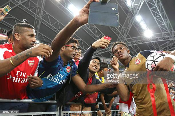 Hat-trick scorer Chuba Akpom of Arsenal celebrates with fans after the Barclays Asia Trophy match between Arsenal and Singapore Select XI at National...